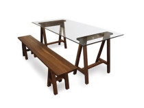 Glass top sawhorse table and bench in natural walnut